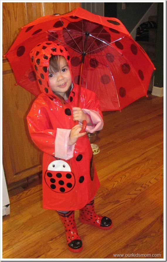 Emma-wearing-ladybug-raingear