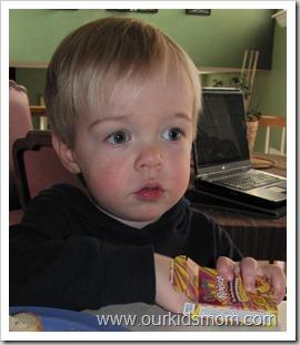 Ethan eating Raisels