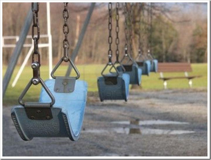 741841-empty-swingset-in-a-park