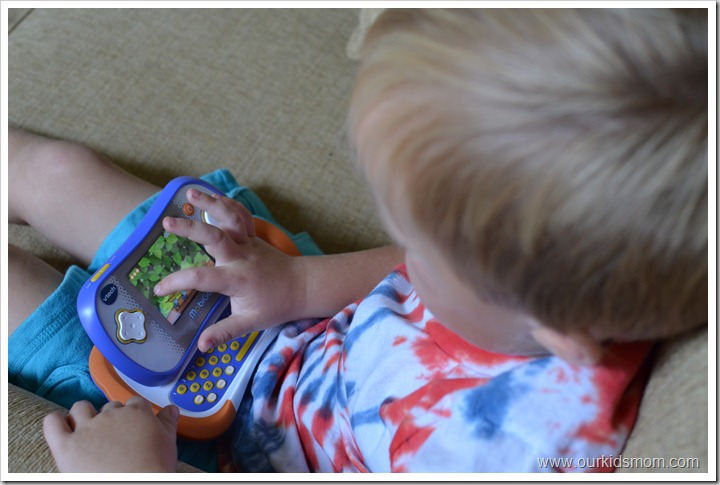 boy playing Mobigo 2 games