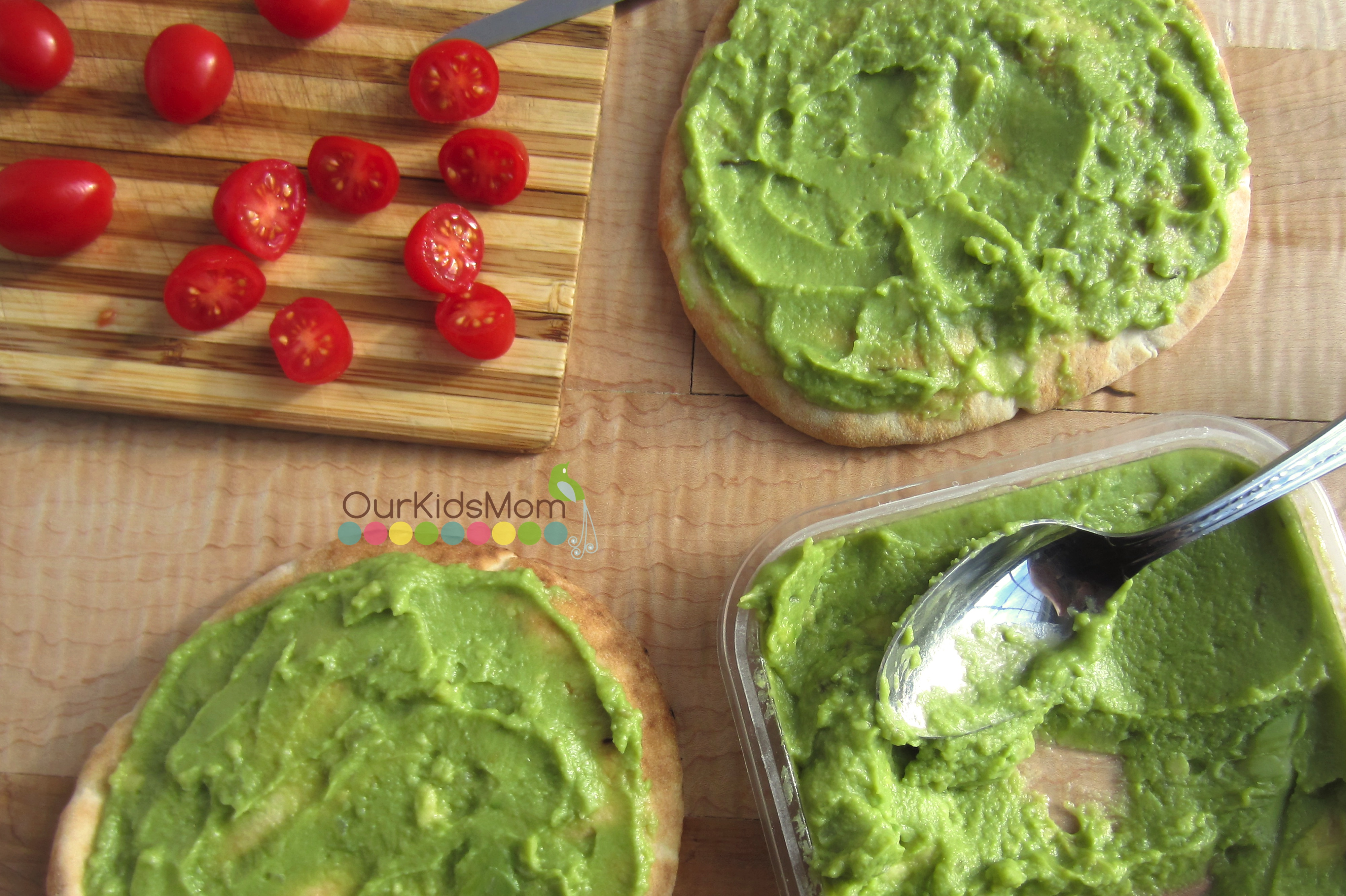 Spread a thin layer of guacamole across each of the pita breads.