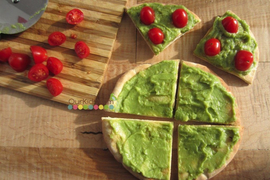 With a knife or pizza cutter, cut each pita bread into 4 equal ...